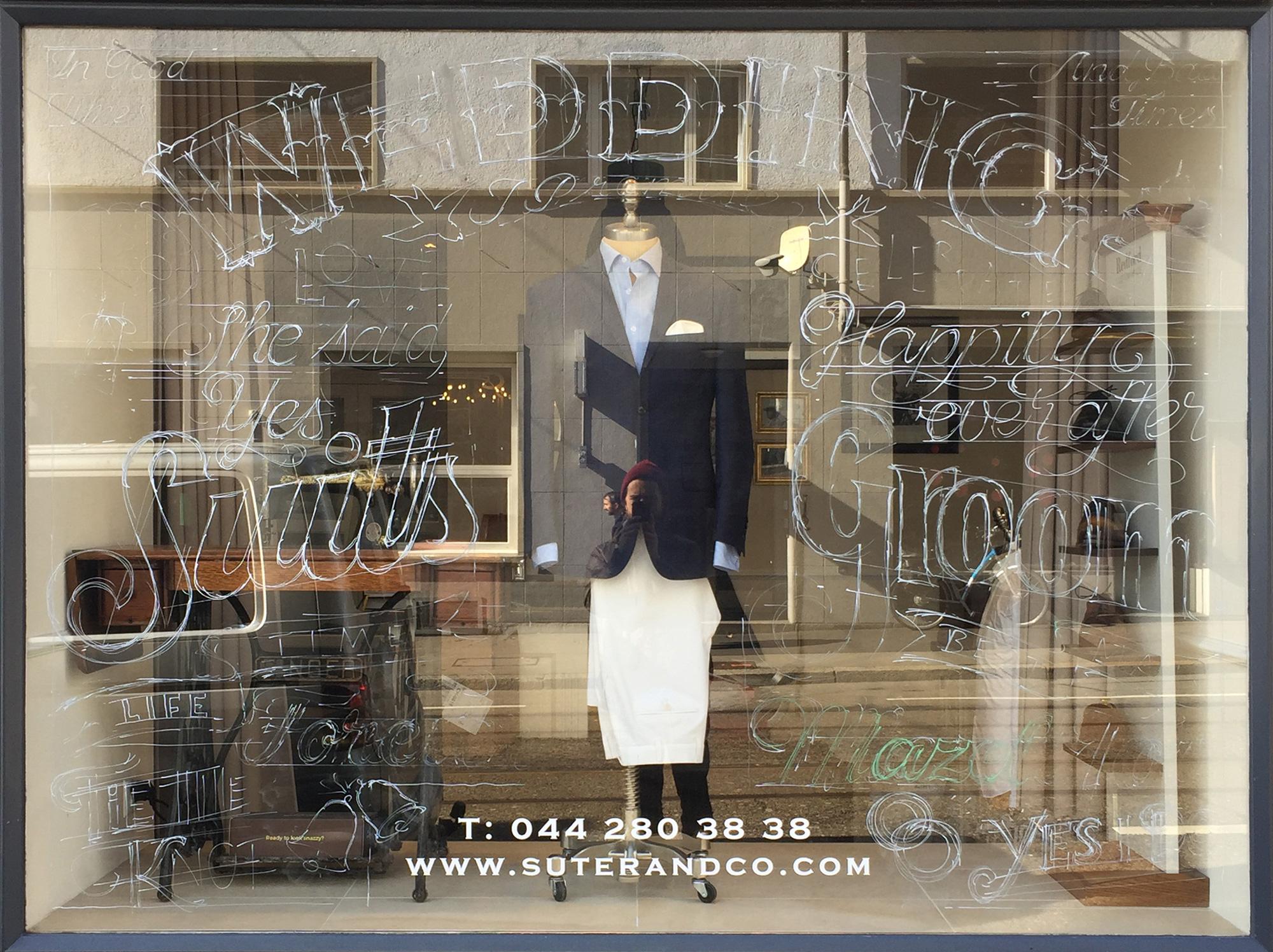 Suits, Wedding, Groom, Suter & Co., Kreidetafel, Schriftenmalerei, Wandbeschriftung, hand gemalt, Tafelbeschriftung, Tafelmaler, sign painting, Zürich, Mathias Truniger, hand lettering, type design, Hinterglasvergoldung, reverse glass gilding, gold leaf